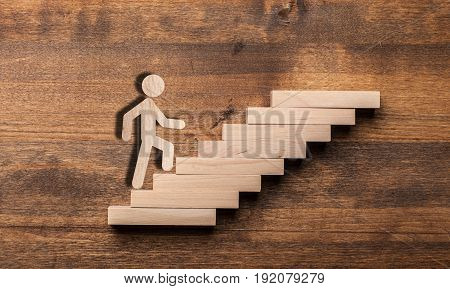 Business wooden businessman climbing competition play background