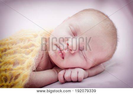 Newborn cute little girl is fast asleep for 18 days