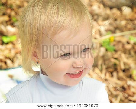 little girl smiling in the Park on a sunny day. joyous emotions of a child