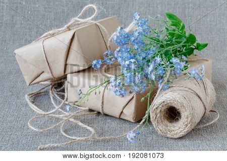 A Bouquet Of Flowers Forget-me-nots With Gift