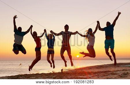 Friends jump beach leisure fun group sky