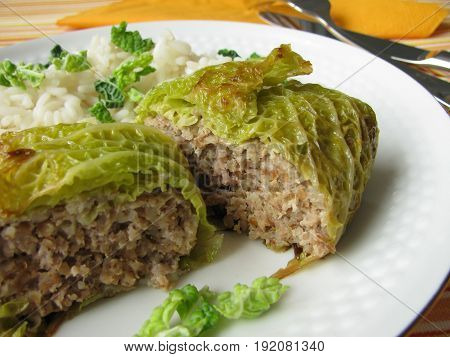 Filled savoy cabbage roulade with minced meat and rice