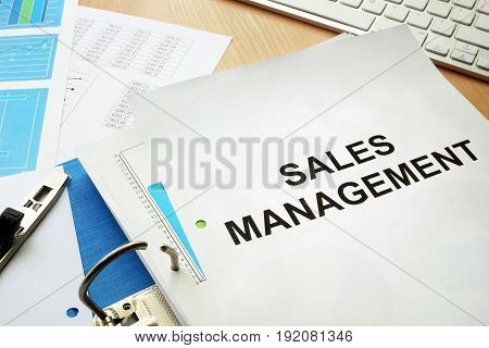 Folder and documents with title sales management.
