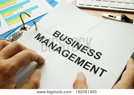Folder and documents with title business management.