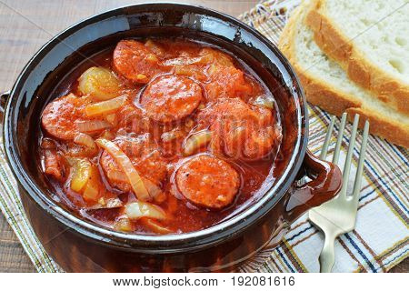 Vegetable stew lecho in ceramic pot with bread