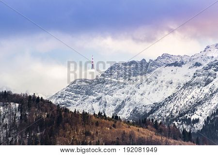 Mountain range landscape in early spring with pine trees