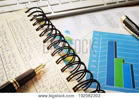 Financial data in accounting book. Business management concept.