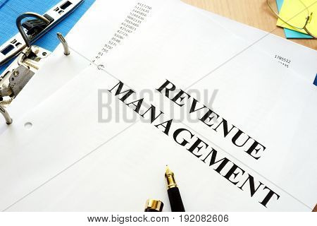 Folder and documents with title revenue management.