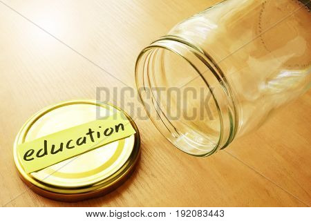 Empty jar with label education. Savings for college concept.