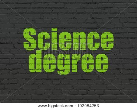 Science concept: Painted green text Science Degree on Black Brick wall background
