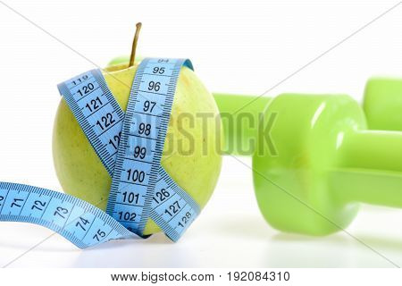 Apple And Blue Sewing Centimeter Near Green Dumbbells