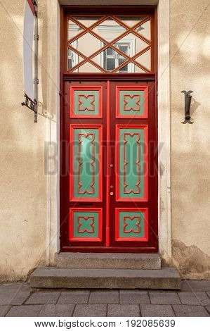 An old beautiful door in the style of the European Middle Ages from the old town in Tallinn
