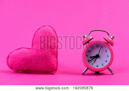 Heart And Alarm Clock, Isolated On Magenta Pink Background
