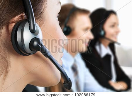 Female center call employee young adult background beautiful
