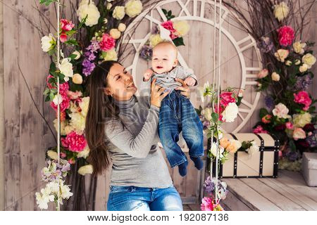 happy smiling child with blue eyes with his mother.