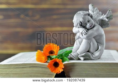Condolence card with angel guardian and flowers