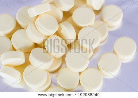 Pharmacy Theme, Yellow Medicine Tablets Isolated On Foil Background