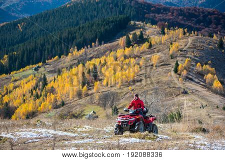 Man Is Driving Off-road Vehicle On A Mountain Road Passes To The Top Of The Mountain Followed By A B
