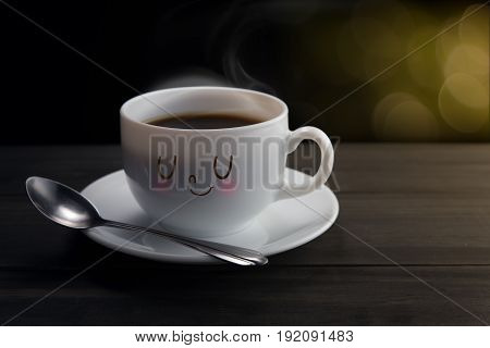 White mug of coffee with a happy smile On bokeh background Good night or Have a happy day concept