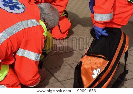 Red Cross provides a first aid to a person injured in a road accident
