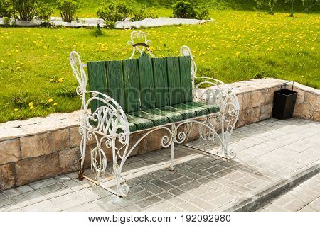 Beautiful Decorative Green Bench On Embankment Of River Moscow In In Sunny Spring Park In Kolomna Moscow Region.