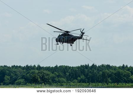 BERLIN GERMANY - JUNE 03 2016: Helicopter NH90 of the German Army. Demonstrative performance. Exhibition ILA Berlin Air Show 2016
