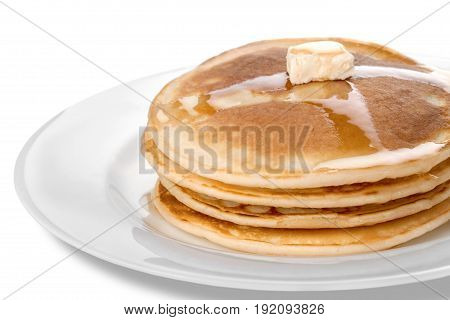 Tasty butter pancakes close up yellow white background