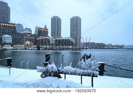 South Boston Massachusetts USA- February 16 2017: Snow covers Harborwalk along Fan Pier with Rowes Wharf in background