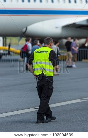 BERLIN GERMANY - JUNE 03 2016: Security staff at the airfield. Exhibition ILA Berlin Air Show 2016