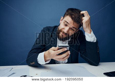 Business man with telephone, business man with documents, business man on blue background.
