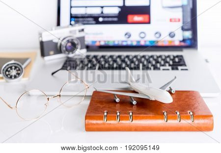 Traveler is using Computer to book his flight for his travel trip