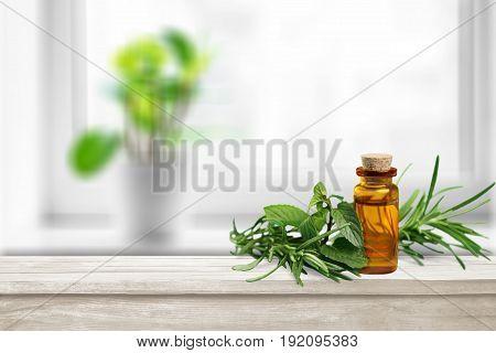 Green oil herbs bottle bottle green table background