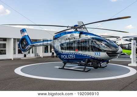 BERLIN GERMANY - JUNE 03 2016: Medium utility helicopter Airbus Helicopters H145 of the German State Police. Exhibition ILA Berlin Air Show 2016