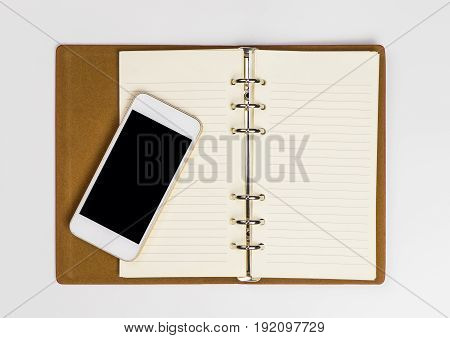 Blank Smartphone on an open notebook page for diary organizer concept