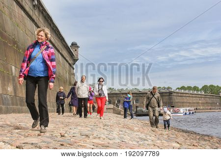 St. Petersburg Russia - 28 May, Tourists on the cobblestone promenade, 28 May, 2017. Famous sightseeing places of St. Petersburg for tourists.