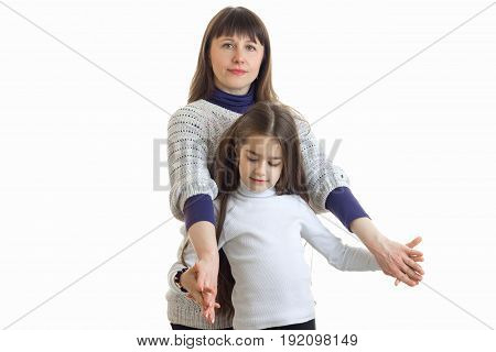 beautiful mom keeps little daughter hands isolated on white background