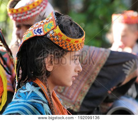Portrait of Kalash tribe woman in national costume at Joshi festival - 14-05-2015 Bumburet Pakistan