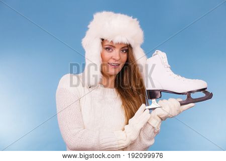 Woman Wearing Winter Hat Holding Ice Skate