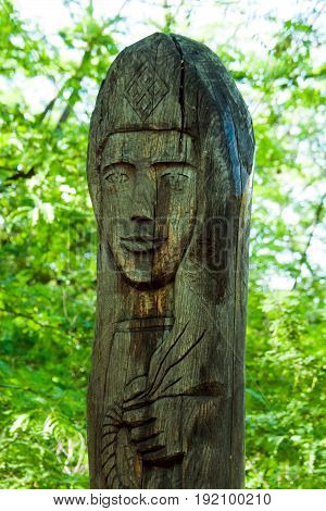Holy old wooden statue of a woman's face