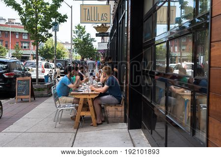 Asbury Park NJ USA --June 18 2017 -- Diners are seated at outdoor tables in Asbury Park on a summer day. Editorial Use Only