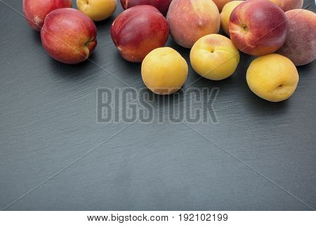 Ripe Apricot And Nectarine On Black Background Of Slate Or Stone