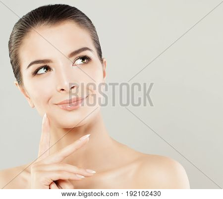 Spa Model Woman with Healthy Skin Smiling and Looking Up. Spa Beauty and Skincare Concept