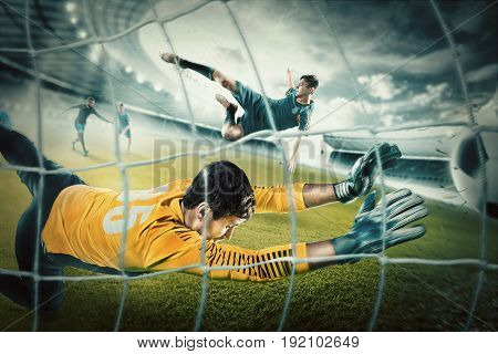 Goalkeeper in gates jumping to catching ball and players in action at stadium. Collage. Advertising concept of soccer football