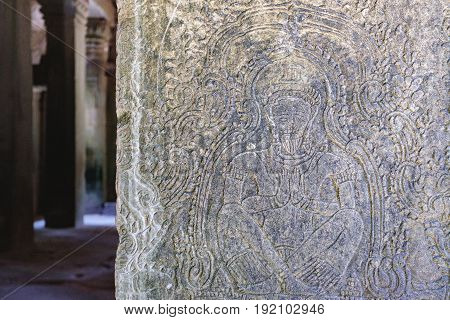 Fragment of old wall in the Preah Khan Temple in Siem Reap, Cambodia. Fresco with a picture of meditation in a lotus pose