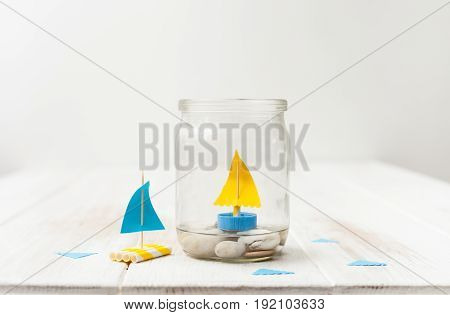 Small Boats From Tubes And Caps From The Bottle