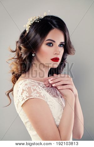 Nice Girl Fashion Model Bride in White Dress. Wedding Makeup and Hair style