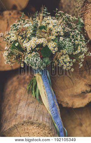 Beautiful wedding bouquet between wooden background broun