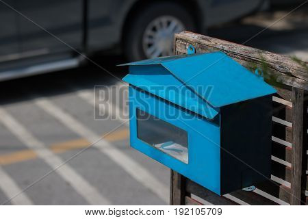 thailand blue post box ; posting a letter to blue british postbox on street