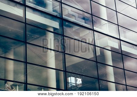 Big glass wall of modern futuristic office business building, reflection, facade building exterior, tined