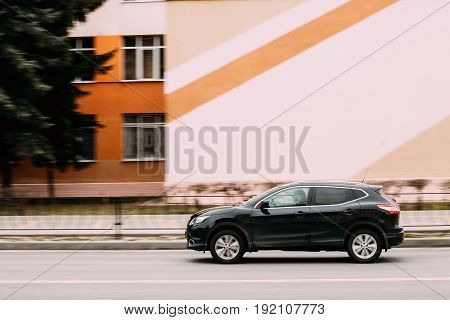 Gomel, Belarus - April 1, 2017: Black Color compact crossover SUV Car Nissan Qashqai In Fast Motion On Street. SUV produced by the Japanese car manufacturer Nissan since 2006